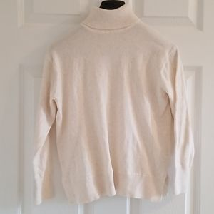 Cream turtleneck.